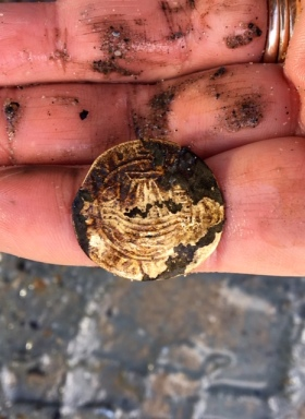 Ship's penny token mucky hands